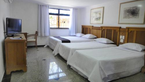 A bed or beds in a room at Hotel Porto Da Aldeia