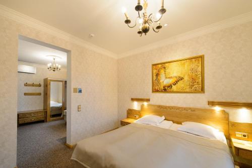 Voodi või voodid majutusasutuse Georgi Hotell toas