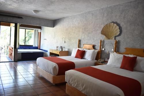 A bed or beds in a room at Hosteria Las Quintas Hotel & Spa