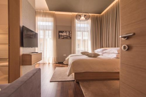 A bed or beds in a room at Luxury Apartments Centre of Opatija