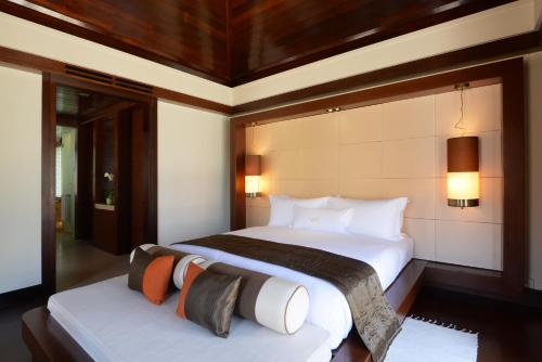 A bed or beds in a room at Gaya Island Resort