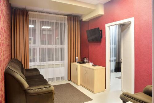 Гостиная зона в Отель Бизнес Холл