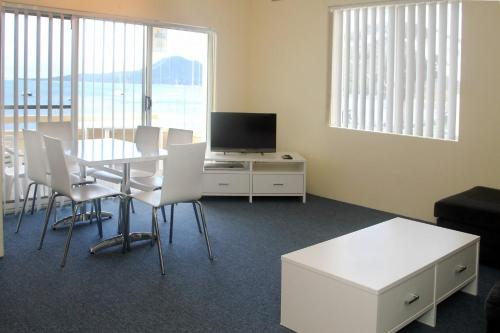 A television and/or entertainment center at Bay Village Unit 20, 47 Shoal Bay Road