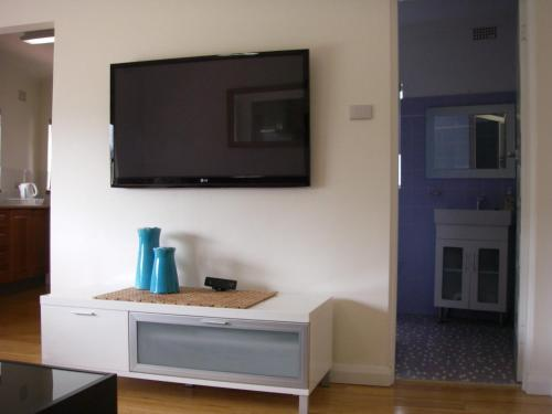 A television and/or entertainment center at Edgewater, 3/145 Shoal Bay Road
