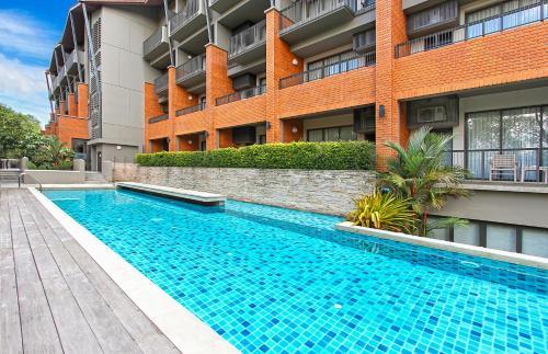 The swimming pool at or near Rimnaam Klangchan Hotel