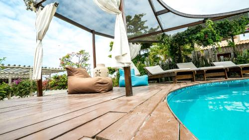 The swimming pool at or close to 0031 Boutique Hotel & Restaurant Cumbuco