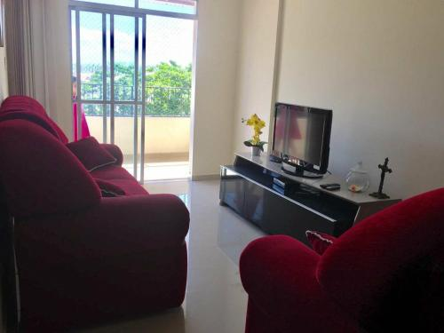 A seating area at Lindo e espacoso apartamento - Aracaju