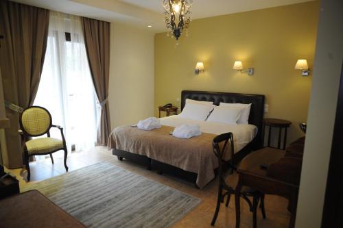 Ένα ή περισσότερα κρεβάτια σε δωμάτιο στο Agapi Luxury Hotel
