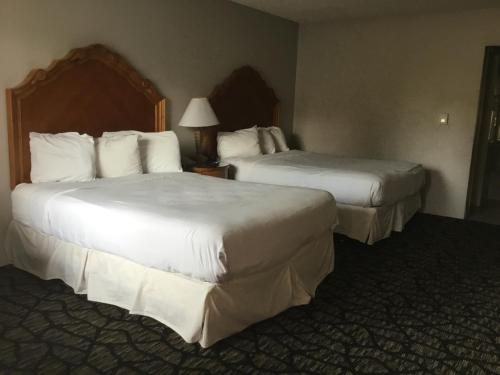 A bed or beds in a room at Aviation Inn