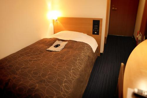 A bed or beds in a room at Hotel Ohta