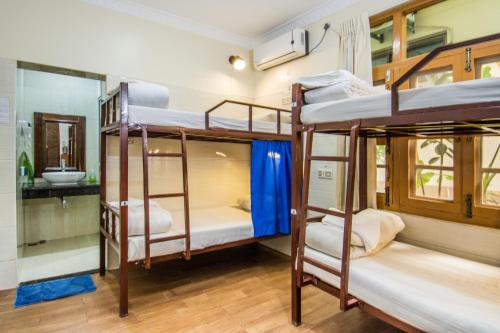 A bunk bed or bunk beds in a room at Mr. Charles Guest House