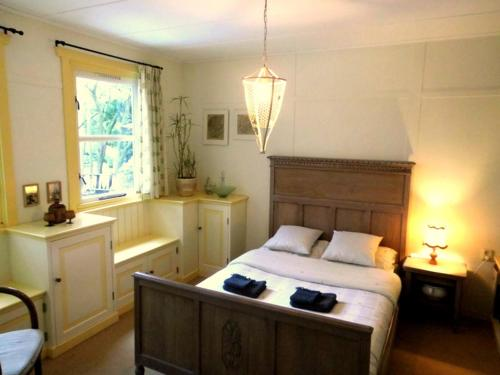 A bed or beds in a room at Casa Lenten B&B