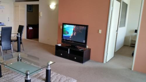 A television and/or entertainment center at Grand Hotel Apartments Gold Coast by owner