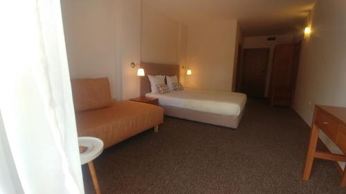 A bed or beds in a room at The Muses Hotel