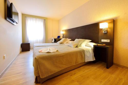 Cama o camas de una habitación en Hotel Spa Norat O Grove 3* Superior