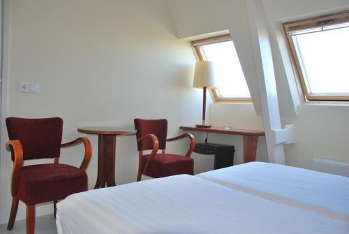Кровать или кровати в номере Hotel Isis