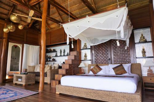 A bed or beds in a room at Vellago Resort