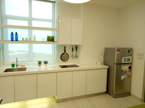 A kitchen or kitchenette at Penang Comfort Suite