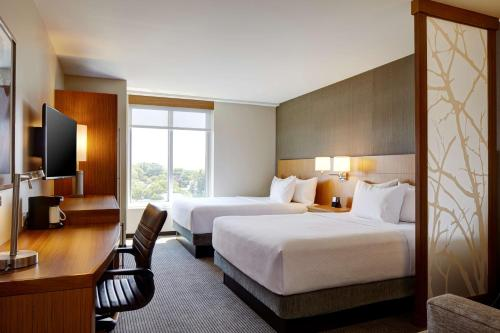 A bed or beds in a room at Hyatt Place New York Yonkers