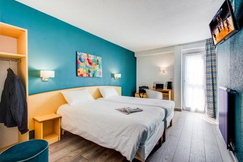 Un ou plusieurs lits dans un hébergement de l'établissement The Originals City, Hôtel Éclipse, Lyon Est (Inter-Hotel)