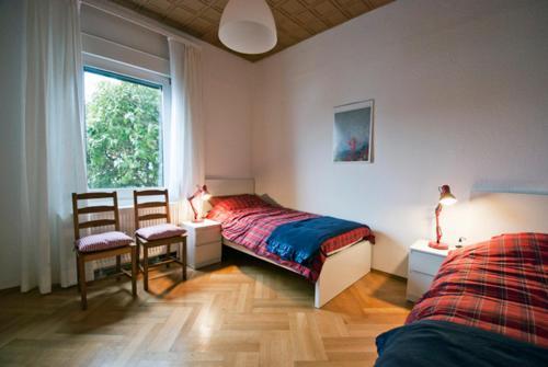 Ein Bett oder Betten in einem Zimmer der Unterkunft Sieben Linden