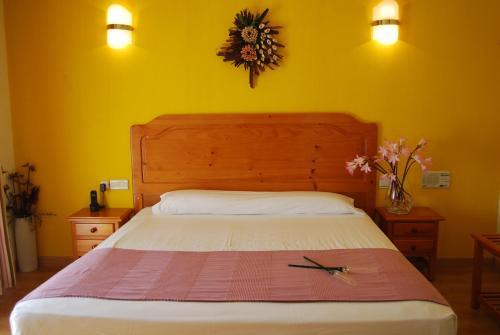 Кровать или кровати в номере Hotel Los Templarios