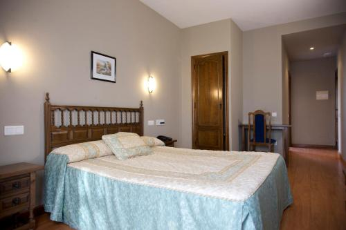 A bed or beds in a room at Hotel Casa Aurelia