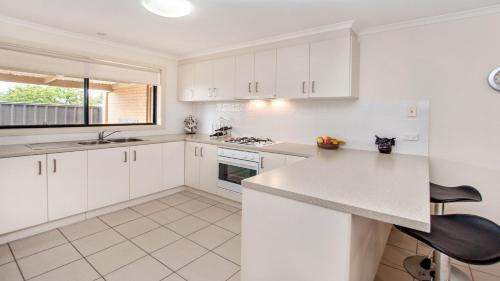 A kitchen or kitchenette at Ulmara Unit 2