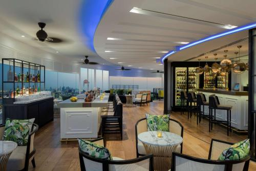 A restaurant or other place to eat at Hyatt Regency Dubai - Corniche