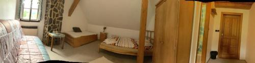 Ein Bett oder Betten in einem Zimmer der Unterkunft Horská chata Jonáš