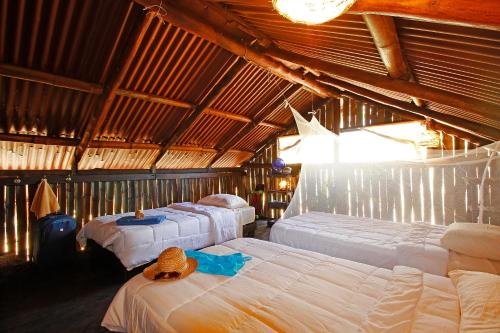 A bed or beds in a room at Barba Negra Lodge