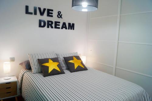 Cama o camas de una habitación en Apartamento Canteras Playa