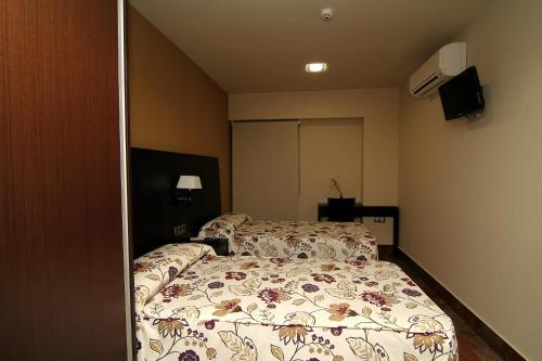 Ein Bett oder Betten in einem Zimmer der Unterkunft Hostal Restaurante La Bartola