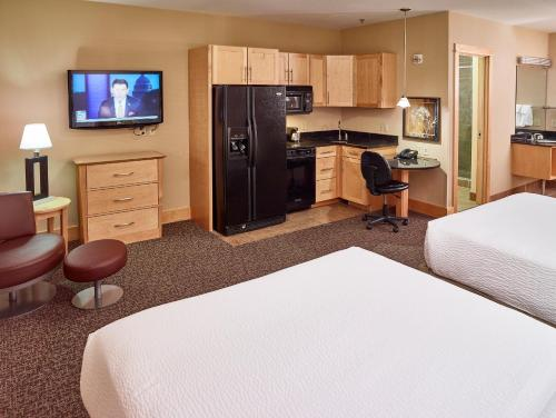 A television and/or entertainment center at LivINN Hotel Minneapolis North / Fridley