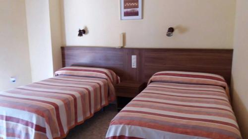 A bed or beds in a room at Hotel Borja
