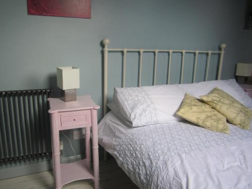 A bed or beds in a room at Grange Guest House