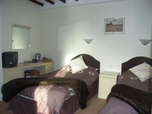 A bed or beds in a room at The Bay Horse Inn