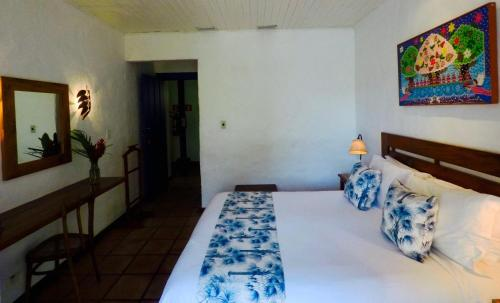 A bed or beds in a room at Pousada Picinguaba