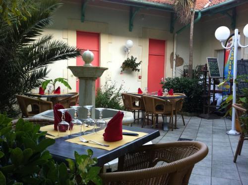 Restaurant ou autre lieu de restauration dans l'établissement Hôtel Orange Marine