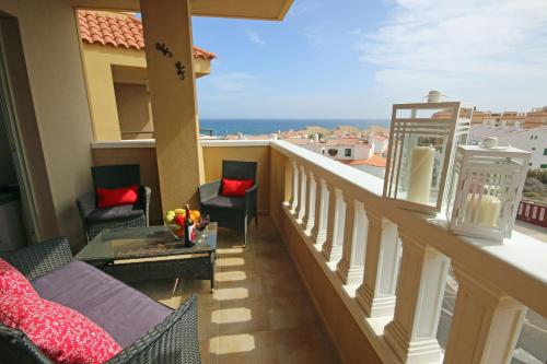 A balcony or terrace at La PERLA sea view & pool