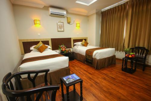 A bed or beds in a room at Immana Grand Inle Hotel