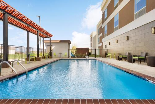The swimming pool at or near Home2 Suites By Hilton Baton Rouge