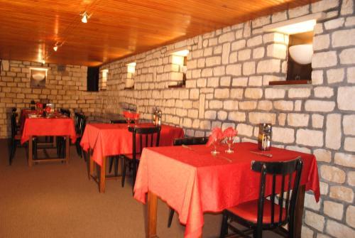 A restaurant or other place to eat at Taverne de la paix