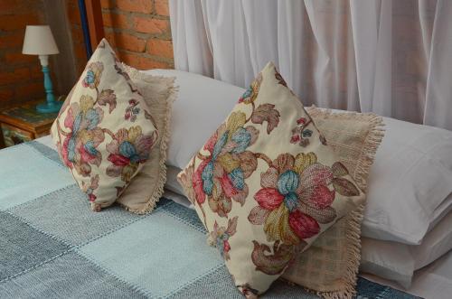 Cama ou camas em um quarto em Pousada La Luna