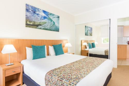 A bed or beds in a room at Ramada Resort by Wyndham Shoal Bay