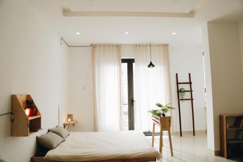 Giường trong phòng chung tại S:House