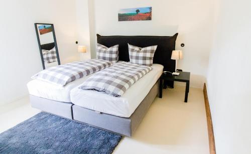 Ein Bett oder Betten in einem Zimmer der Unterkunft Wilhelmshof Feggendorf