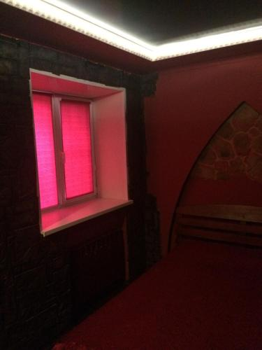 Кровать или кровати в номере 1000 i Odna Noch Inn