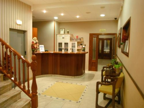The lobby or reception area at Hotel Clemente