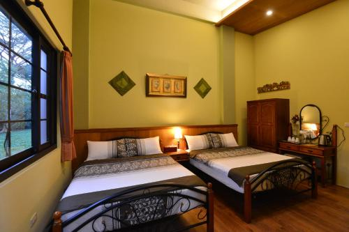 A bed or beds in a room at Amrita Green Retreat